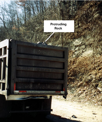 Photo showing truck with protruding rock