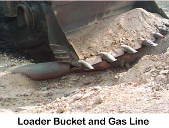 Photo of Loader Bucket and gas line